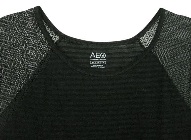 Preload https://img-static.tradesy.com/item/20228131/american-eagle-outfitters-black-women-s-knit-short-sleeve-sz-medium-vguc-blouse-size-10-m-0-1-650-650.jpg