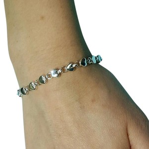 Tiffany & Co. Tiffany And Company Heart Link Bracelet. Continuous Hearts In Sterling Silver. Halmarked And Signed.