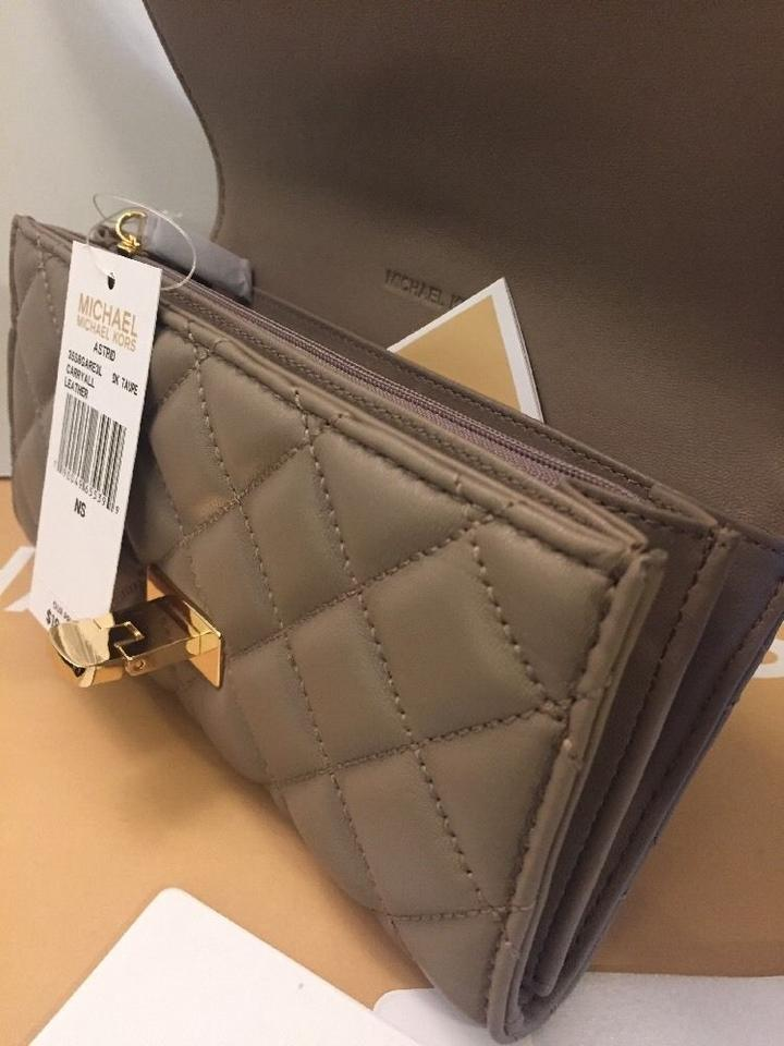 a3d740df319b Michael Kors Dark Taupe Astrid Carryall Quilted Leather Wallet - Tradesy