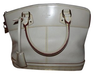 Louis Vuitton Leather Black Tote in light beige