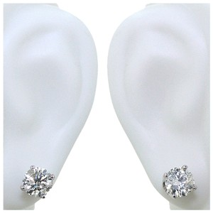 ABC Jewelry 14kt white gold earrings set with two genuine brilliant cut diamonds with a total weight of .99ct