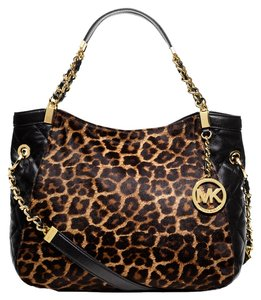 12d51ae65e56fc Added to Shopping Bag. Michael Kors Cheetah Print Calf Hair Gold Hardware Tote  in Black