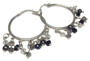 9.2.5 Gorgeous and unique sterling silver hoop earrings.