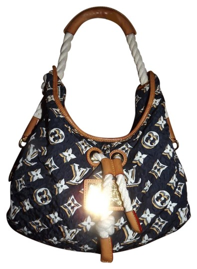 Preload https://item5.tradesy.com/images/louis-vuitton-bulles-gm-cruise-2010-collection-rare-navy-canvas-and-leather-shoulder-bag-20243049-0-1.jpg?width=440&height=440