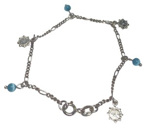 9.2.5 Sterling silver bracelet with sun charms and blue decorative ball