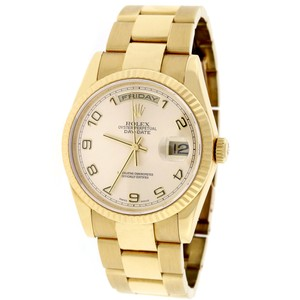 Rolex Rolex President Day-Date Gold Champagne Arabic 36mm Oyster 118238