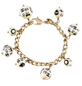 Chanel Gold-tone Chanel chain ling CC faux pearl charm bracelet