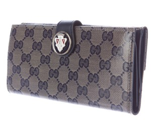 Gucci Navy, tan GG crystal coated canvas Gucci Hysteria wallet