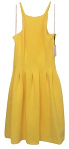 Calvin Klein short dress Yellow with gold zipper on Tradesy