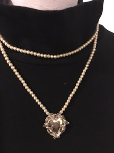 Other Ladies Pearl Necklace w/Silver cherub Pendant