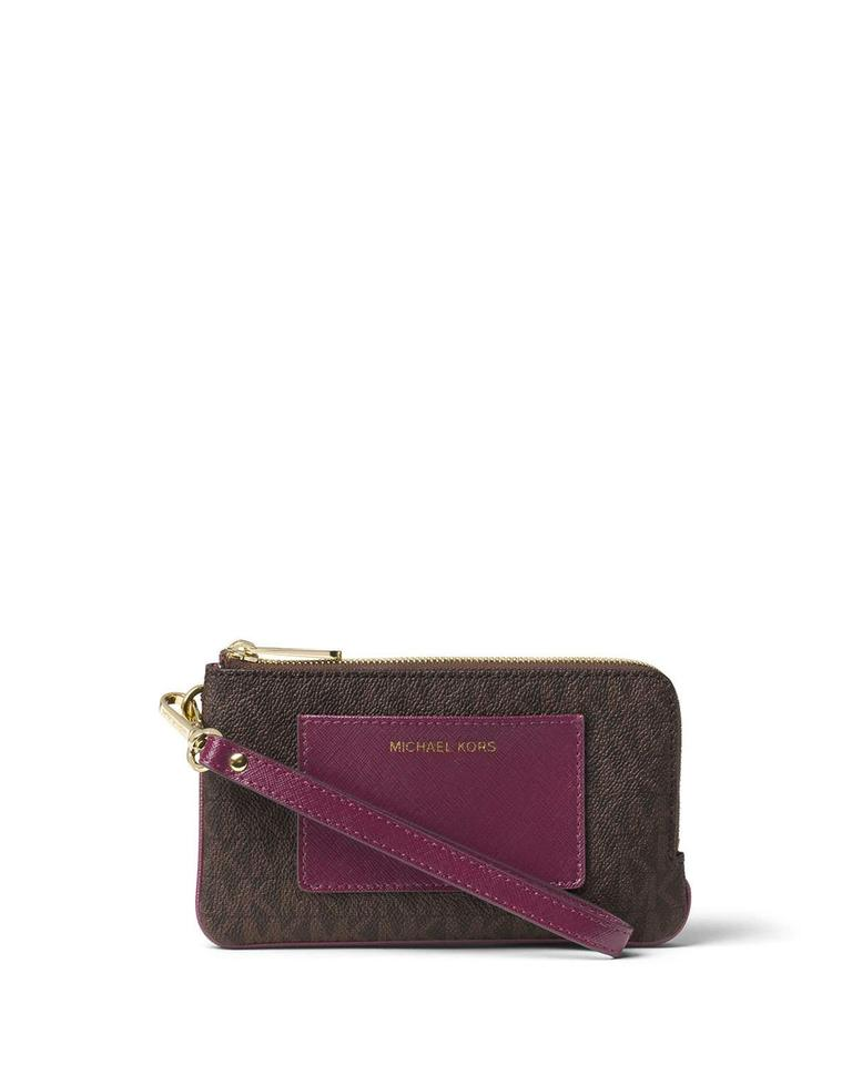 dd330cd91191 Michael Kors Double Zip Pocket Medium Brown/Plum Wristlet - Tradesy