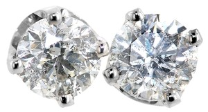 ABC Jewelry 14kt white gold earrings set with two genuine brilliant cut diamonds with a total weight of 1.42ct