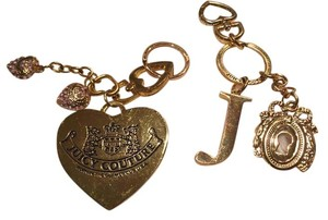 Juicy Couture Two juicy couture key charms.