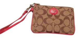 Coach Wristlet in Beige With Berry Lining