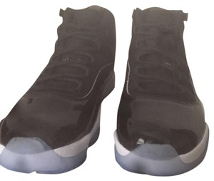 Air Jordan Black. The bottom of the shoe is blue Athletic