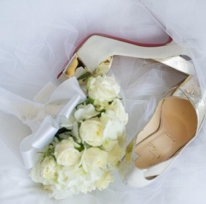 Christian Louboutin Gold and white Platforms