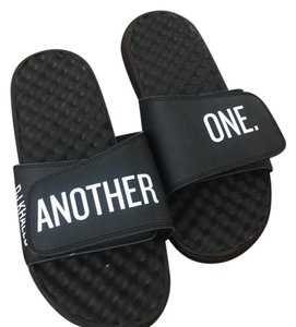we the best black Sandals