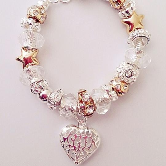 Preload https://item3.tradesy.com/images/charm-bead-clear-transparent-european-heart-gold-white-new-gift-star-heart-bridesmaid-bracelet-2027967-0-0.jpg?width=440&height=440