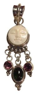 Moon Face Carving Sterling Silver Moon Face Pendant With Tourmaline And Garnets