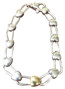 Tiffany & Co. Tiffany and Company 18 karat yellow gold heart link sterling silver link bracelet