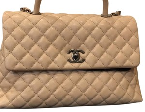 Chanel caviar medium coco handle Satchel in Beige