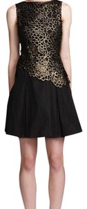 Kung Katherine short dress Black and Gold Cocktail on Tradesy