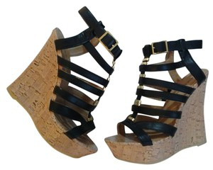 Mark and Maddux Black and gold Platforms