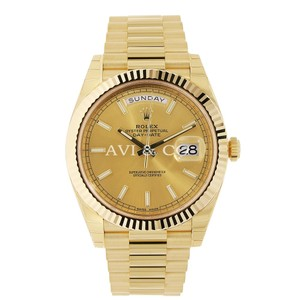 Rolex Rolex Day-Date 40 18K Yellow Gold Watch Champagne Index Dial 228238