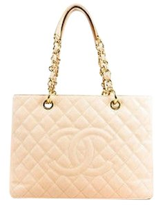 Chanel Caviar Leather Quilted Gold Chain Grand Shopping Tote in Beige