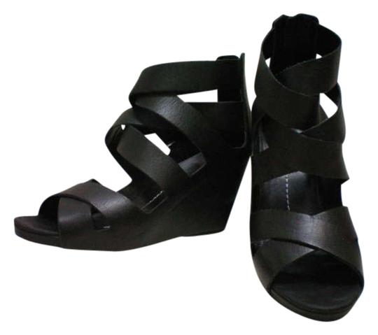Preload https://item5.tradesy.com/images/dolce-vita-black-pali-leather-wedges-size-us-85-202914-0-0.jpg?width=440&height=440
