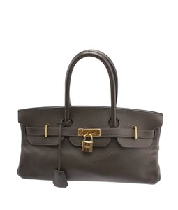Hermès Leather Gold Tone Satchel in Brown