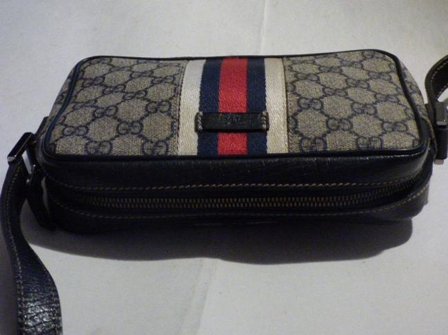 Gucci Purses/Designer Purses Navy Large G Logo Print & Navy Leather with A Wide Red & Navy Stripe Coated Canvas Cross Body Bag Gucci Purses/Designer Purses Navy Large G Logo Print & Navy Leather with A Wide Red & Navy Stripe Coated Canvas Cross Body Bag Image 6