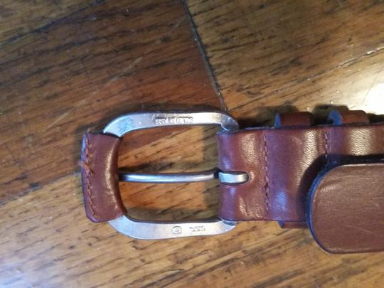 Other small brown belt with brass buckle