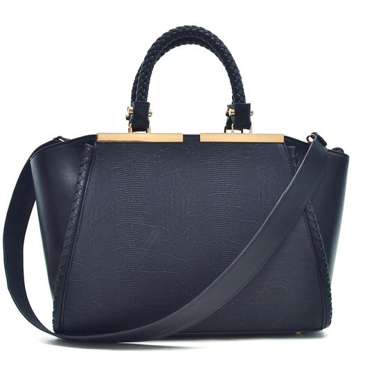 Preload https://img-static.tradesy.com/item/20307840/two-tone-winged-black-faux-leather-satchel-0-0-540-540.jpg