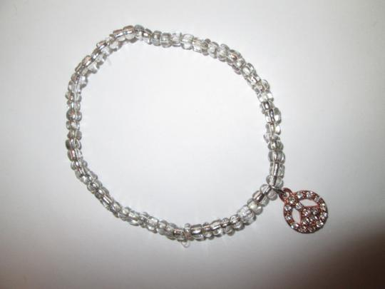 Other 4 bracletts / 2 pink/ 1 blue/ 1 clear with peace sign charm. Costume Image 2