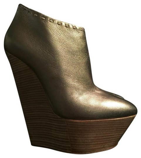 Preload https://img-static.tradesy.com/item/20309082/giuseppe-zanotti-boots-wedges-size-us-8-narrow-aa-n-0-0-540-540.jpg