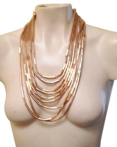 Other 9 strand mesh and tube gold necklace