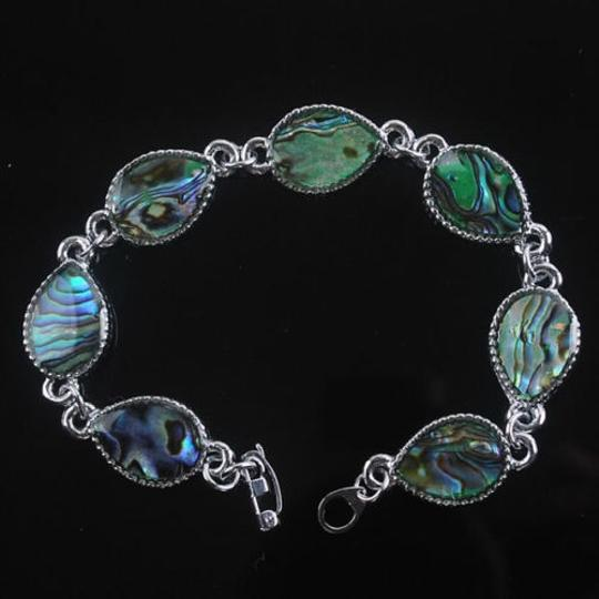 Preload https://item2.tradesy.com/images/multi-colored-bogo-free-abalone-shell-free-shipping-bracelet-2032206-0-0.jpg?width=440&height=440