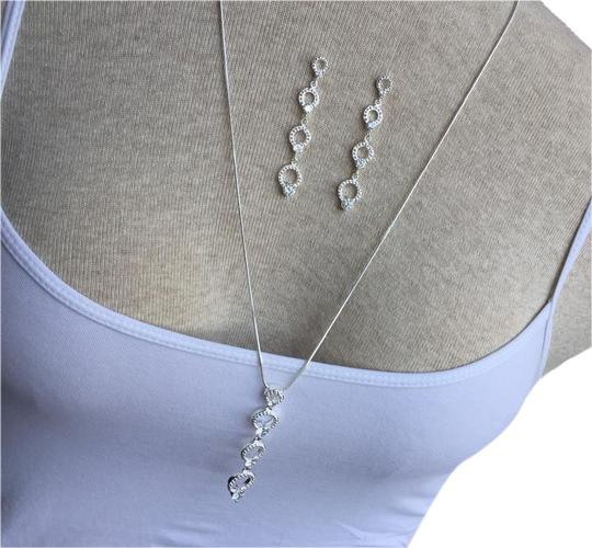 Preload https://img-static.tradesy.com/item/20324238/silver-and-crystal-earring-set-necklace-0-1-540-540.jpg