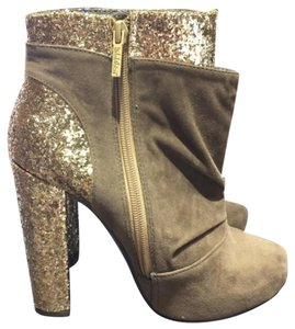 Michael Antonio gold Boots