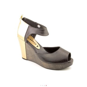Cri de Coeur black, gold, dark stained wood Wedges