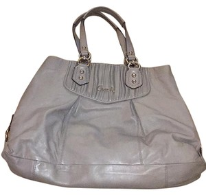 Coach Satchel in gray exterior and pink interior