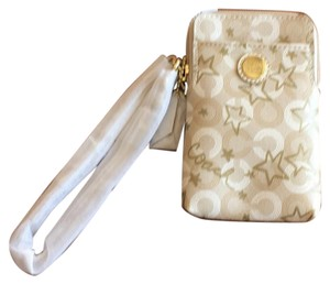 Coach Wristlet in golds and creams