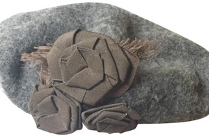 Hat Attack Beret in gray with brown flowers.