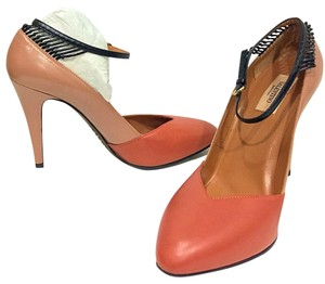 Valentino browns, hint of pinks with black trim! Pumps