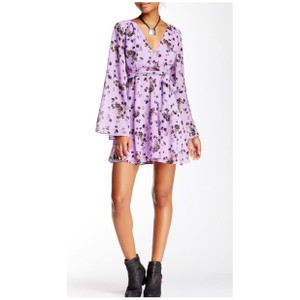Free People short dress Lilou Flared Self-tie Floral Flowy on Tradesy