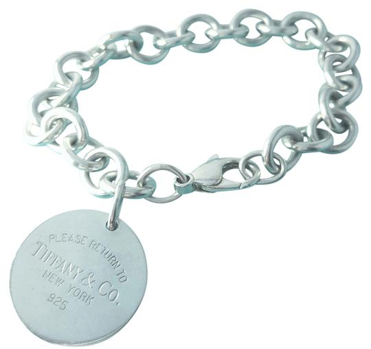 Preload https://item4.tradesy.com/images/tiffany-and-co-pretty-please-return-to-round-tag-75-guaranteed-comes-with-pouch-and-bracelet-20368528-0-1.jpg?width=440&height=440