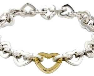 Tiffany & Co. LIMITED EDITION!!! Tiffany & Co. Open Heart Bracelet With Interlocking Clasp 18 Karat Yellow Gold and Sterling Silver 7