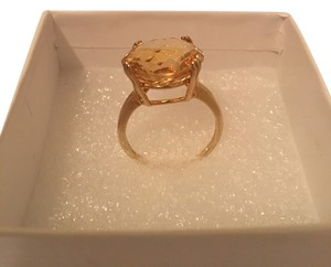 Solitaire Citrine and gold tone ring; Size 8