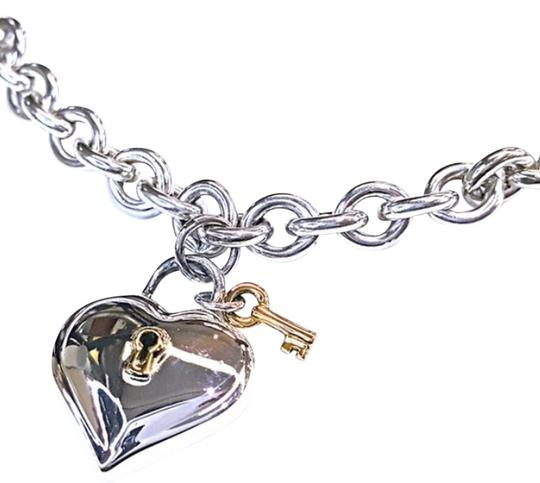 Preload https://img-static.tradesy.com/item/20376295/tiffany-and-co-rare-and-retired-18-karat-yellow-gold-and-sterling-silver-gold-heart-and-lock-charm-1-0-3-540-540.jpg
